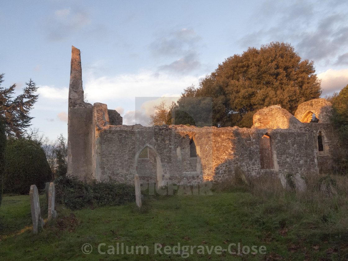soft sunset light on old ruined burnt down Alresford Church