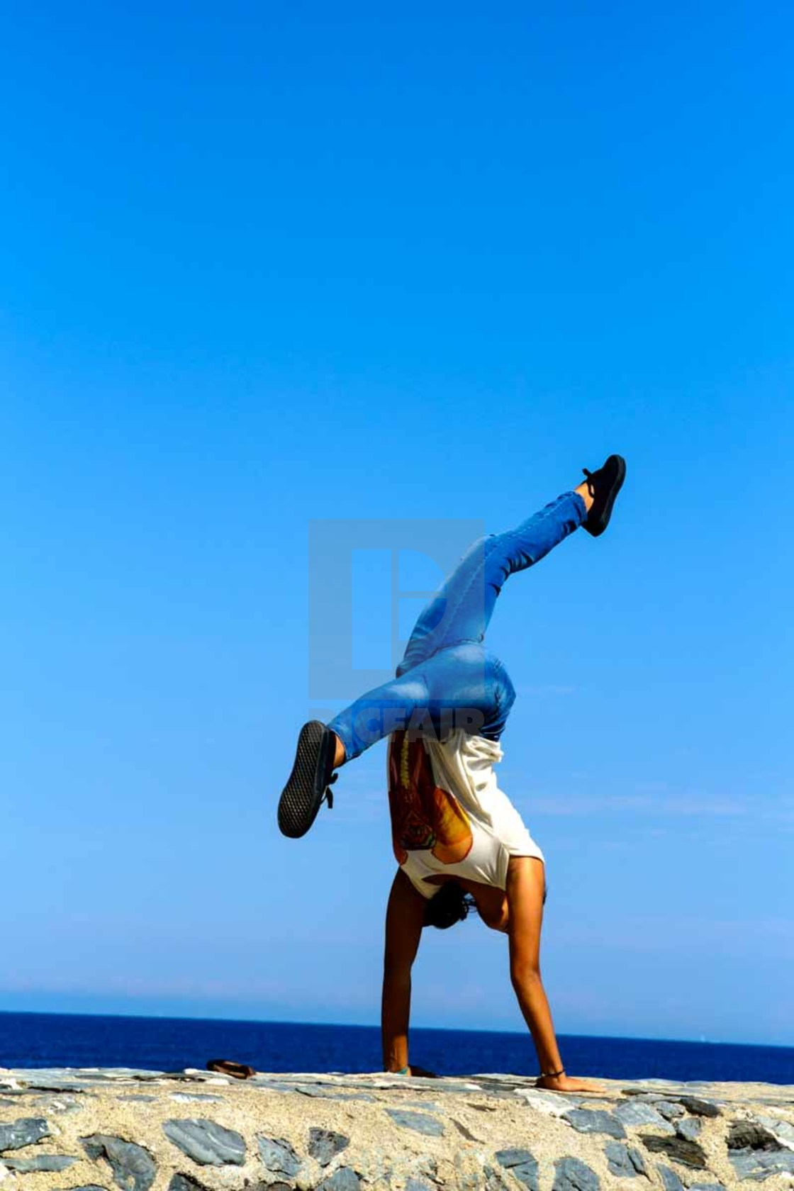 """Cartwheel on rock wall"" stock image"