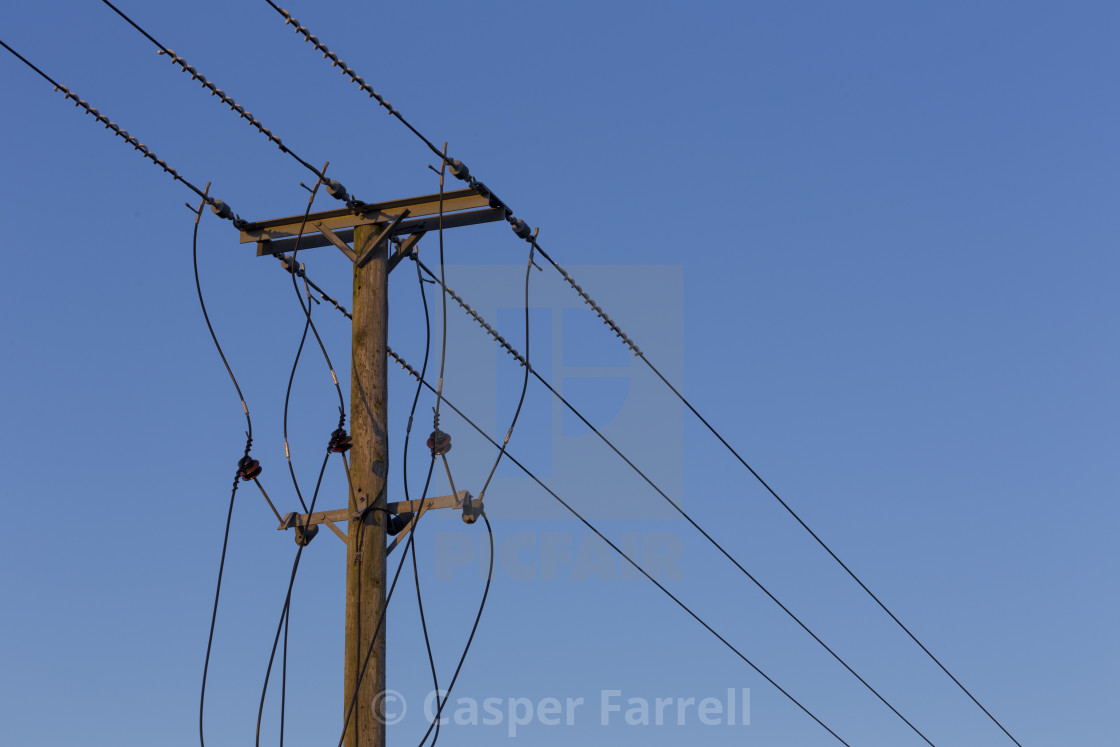 Electricity telegraph pole in Red glow sunset light - License for ...