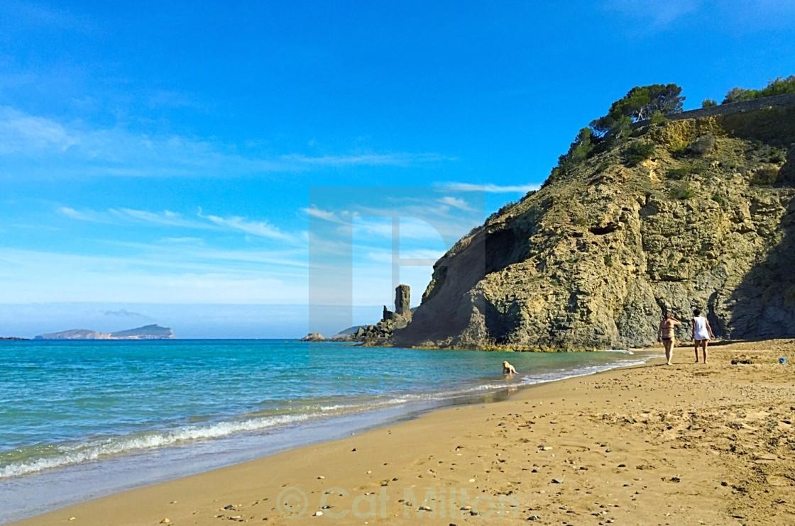 Beautiful day at Aguas Blancas Beach - License, download or print