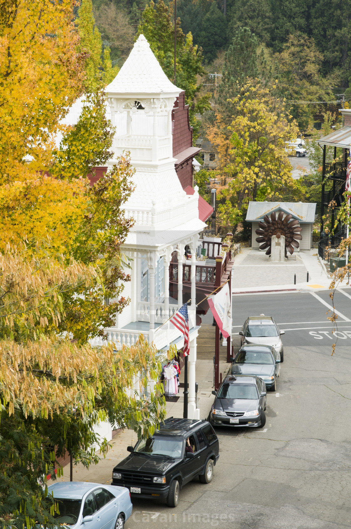 """Historic Nevada City firehouse built in 1861 framed by fall leaves"" stock image"