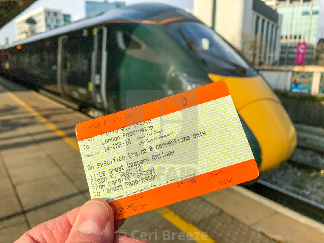 Rail ticket with an inter city express train in the background