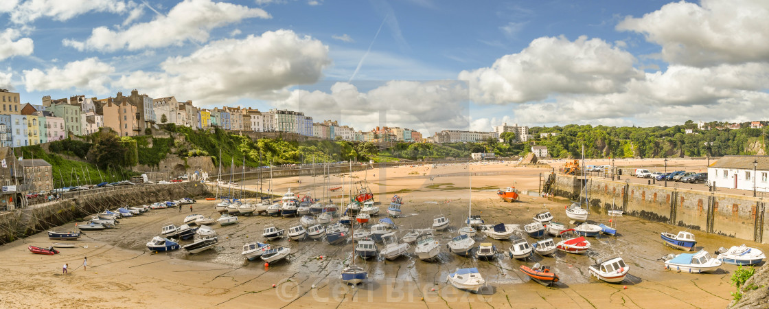 """Panoramic view of the harbour in Tenby, West Wales, at low tide"" stock image"