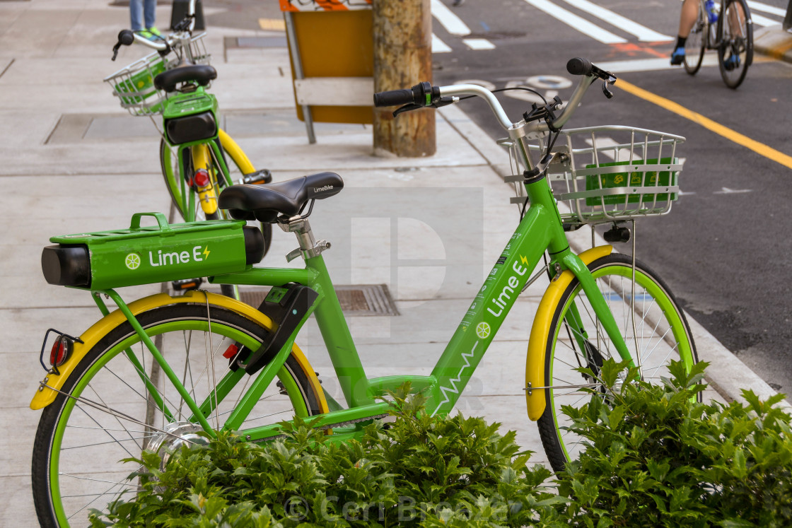"""""""Lime Bike bicycle left on a street in Seattle city centre."""" stock image"""