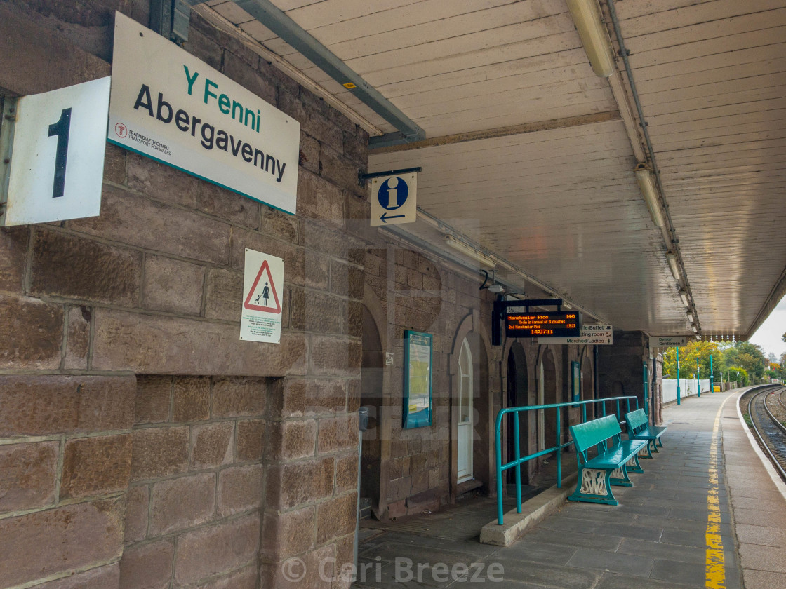 """Bilingual station name sign at Abergavenny railway station."" stock image"