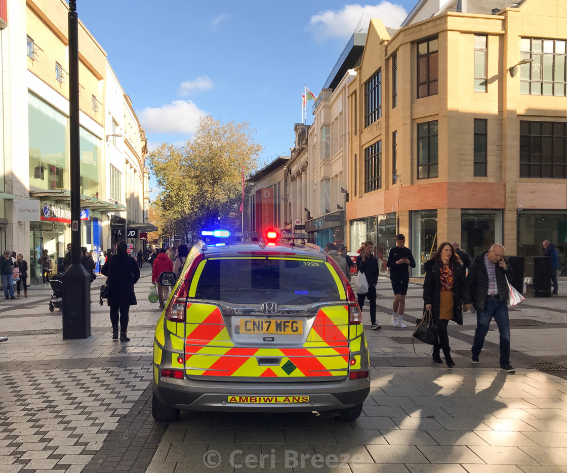 """Paramedic rapid response vehicle with blue lights flashing in Cardiff city centre."" stock image"