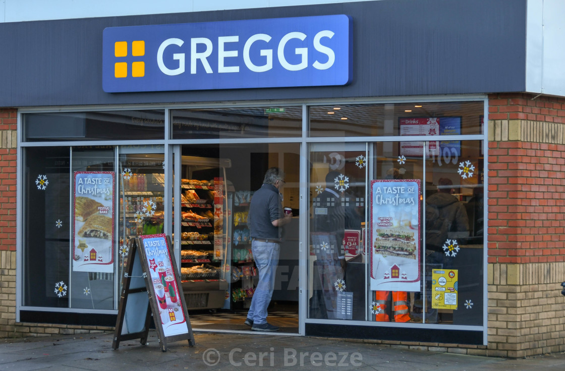 """Customer entering a branch of the Greggs"" stock image"