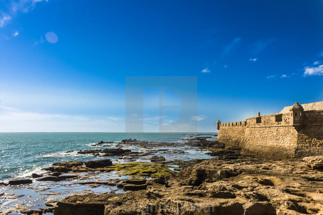 Moss Covered Rocks Off The Coastline Of Castillo De San Sebastian