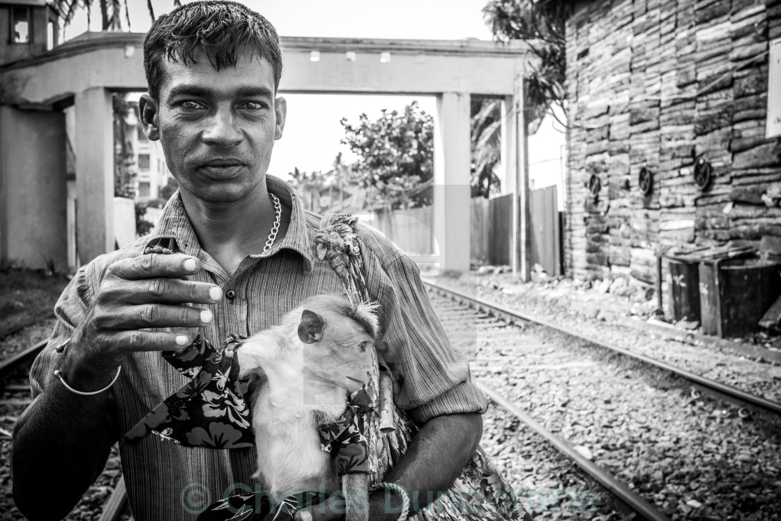 """Monkey Handler on Train Tracks"" stock image"