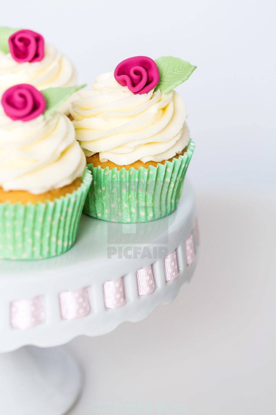 """Floral cupcakes on a cakestand"" stock image"