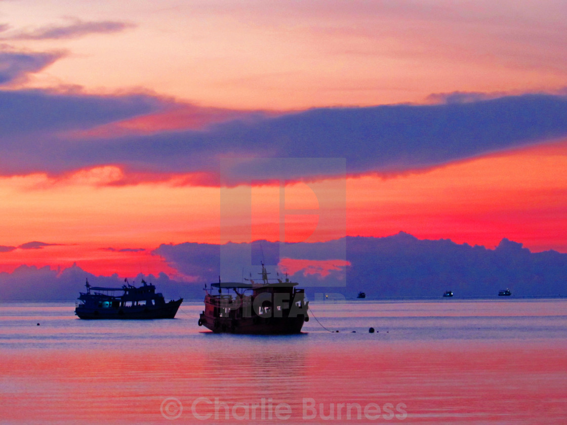 """Dive Boats at Sunset"" stock image"