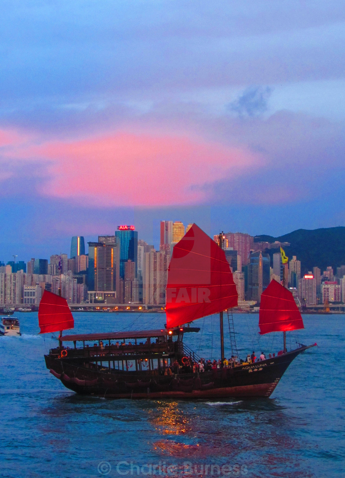 """""""Junk in Hong Kong Harbour at Sunset"""" stock image"""
