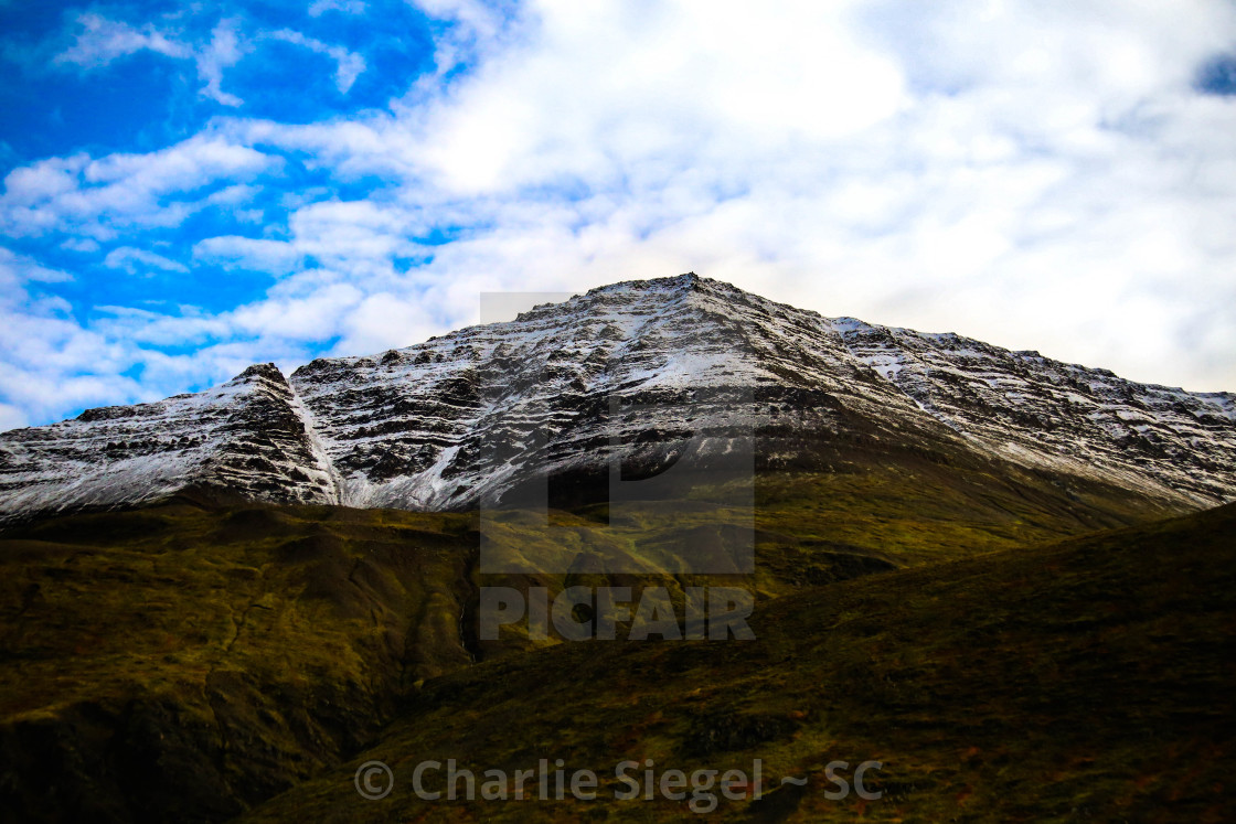 """Snow Covered Icelandic Hills"" stock image"