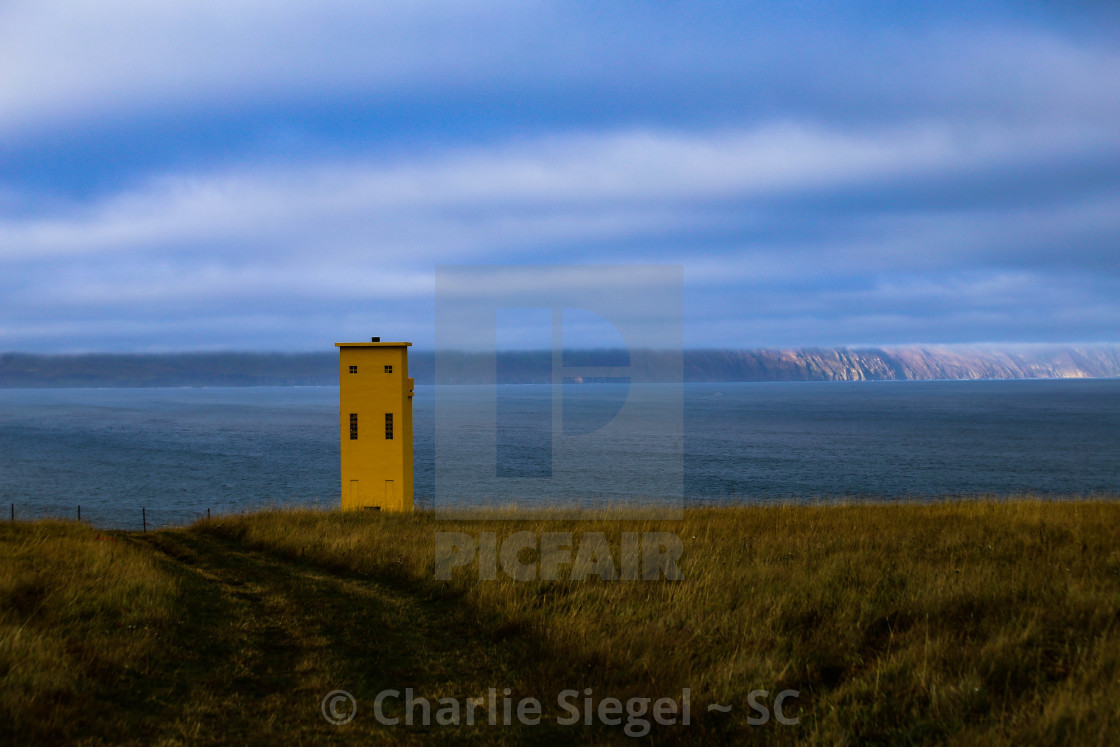 """Yellow Husavik Lighthouse in Northern Iceland"" stock image"