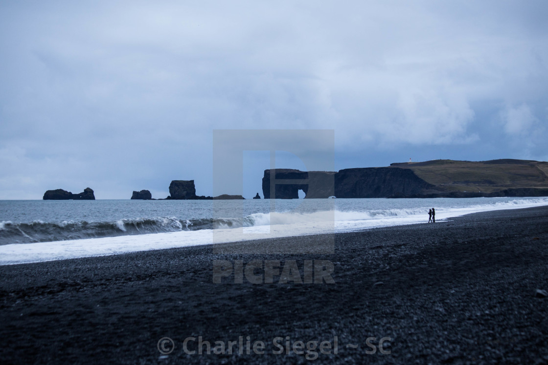 """Two People on Reynisfjara Beach, Iceland"" stock image"