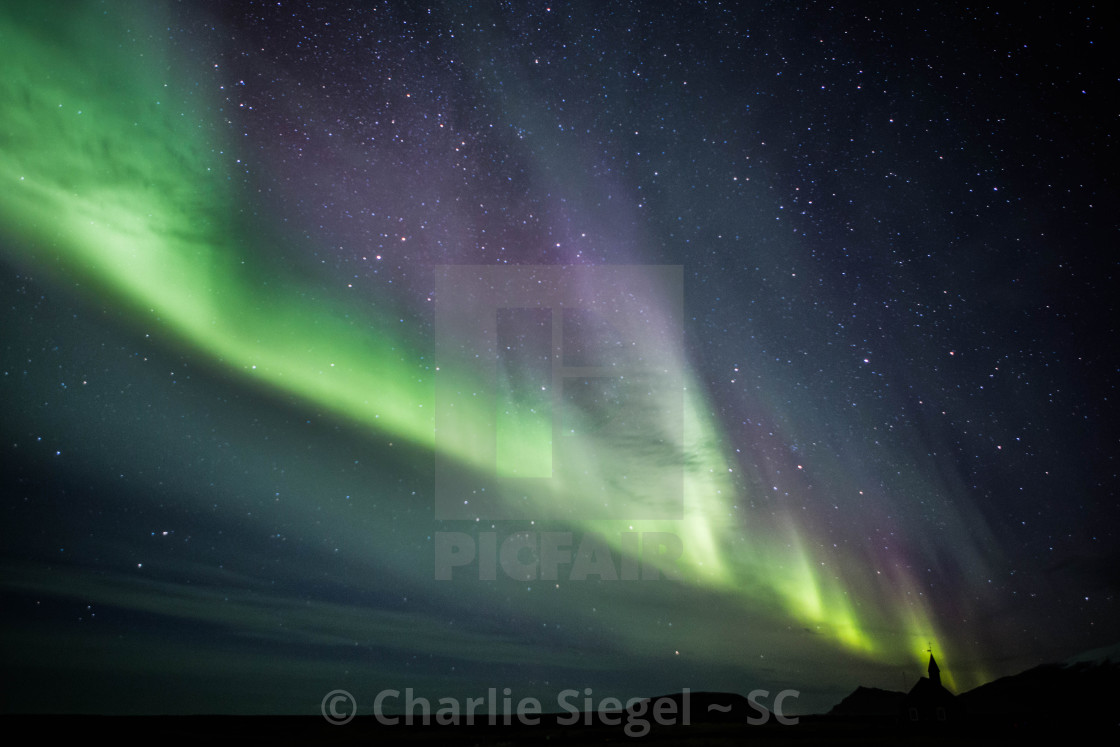 """Northern Lights over Budir Church Iceland"" stock image"