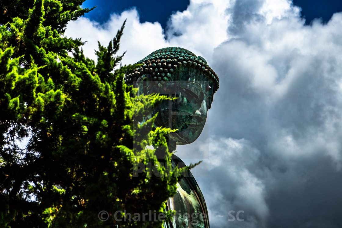 """The Great Buddha of Kamakura Japan before a Cloud-Filled Sky"" stock image"