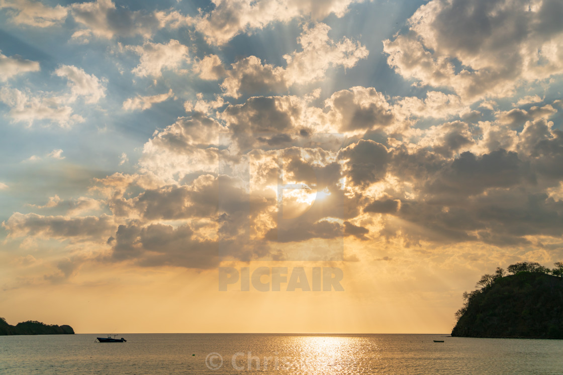 """Dramatic sky at sunset off the Pacific coast of Costa Rica, in the Guanacaste..."" stock image"