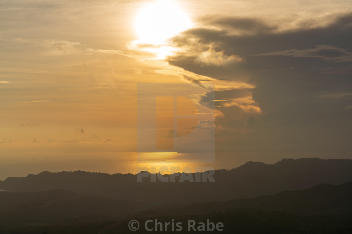 """Just before dawn on the Pacific coast of Costa Rica, near Jaco."" stock image"
