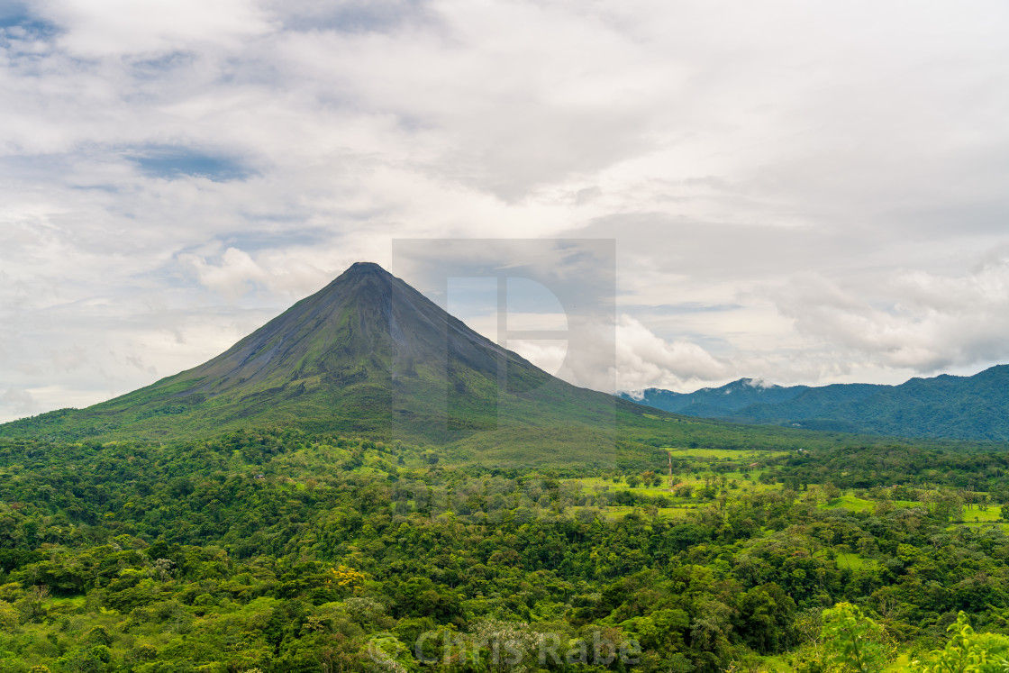 """Arenal Volcano, which has an almost perfect cone shape, is one of the biggest..."" stock image"