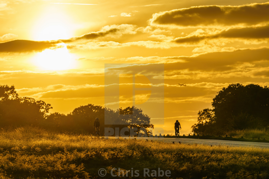 """London, Enlgand - September 7 2018: two cyclists cycling through Richmond..."" stock image"