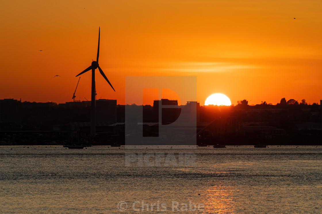 """Wind Turbine dominating the skyline at sunset in Slade Green near dartford..."" stock image"