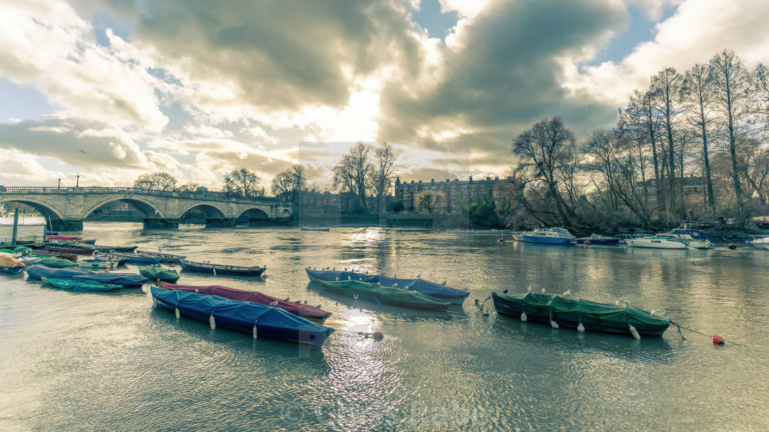 """The Thames flowing through Richmond-Upon-Thames as the sun is starting to..."" stock image"
