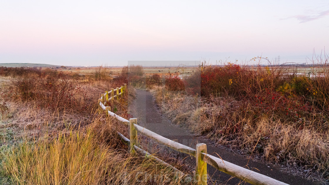 """A view following the path past Rainham Marshes on a cloudy winter morning"" stock image"