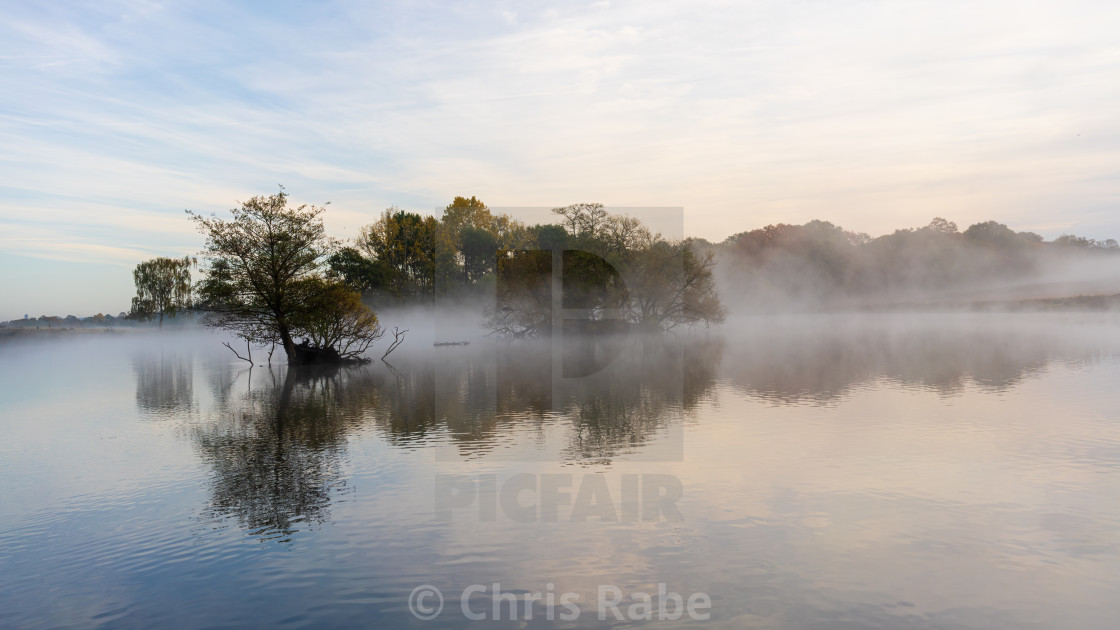 """The Pen Ponds in Richmond Park on a foggy morning in October just after sunrise"" stock image"