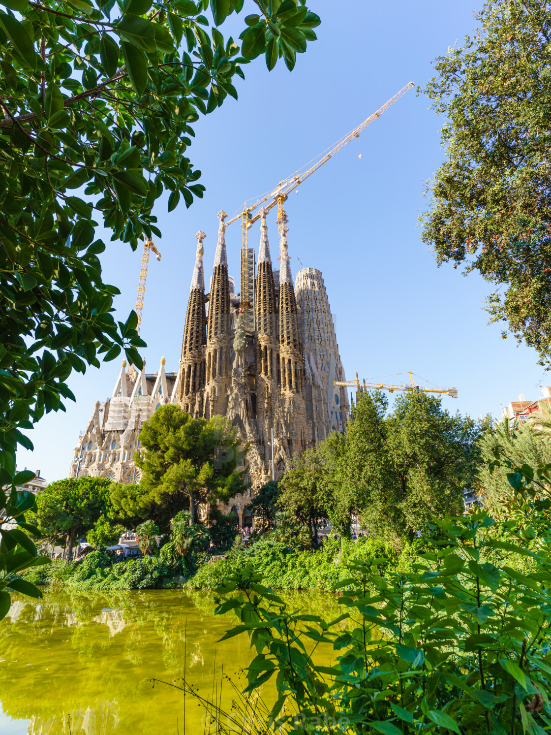 """Sagrada Familia viewed from across a pond on a clear autumn day in Barcelona,..."" stock image"