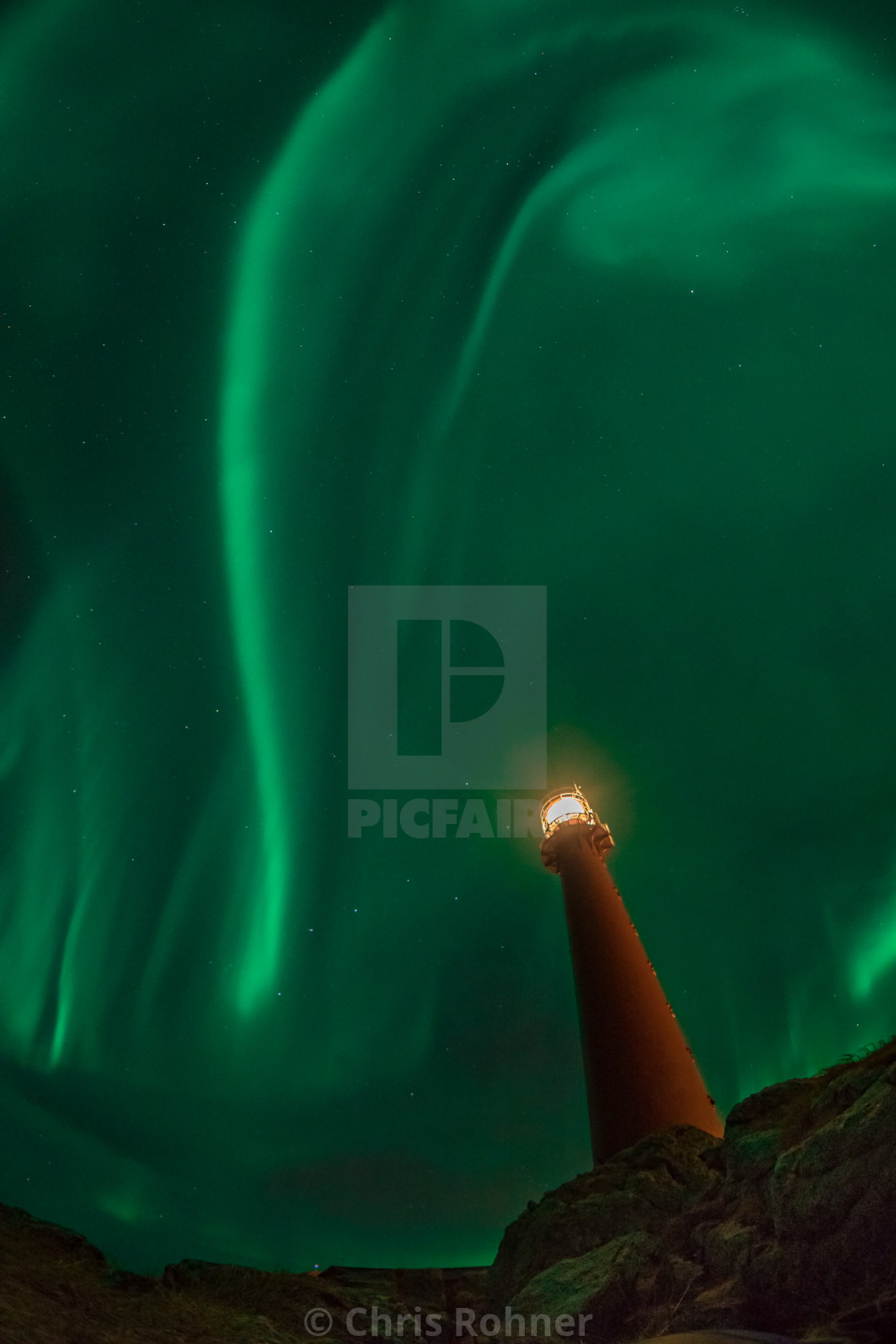"""Northern lights over a lighthouse"" stock image"