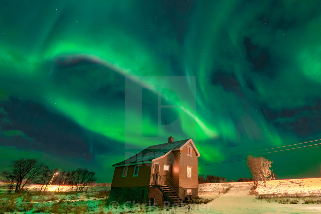 """Northern lights above an old farm house"" stock image"