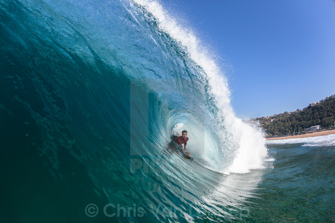 """Surfing Rider Hollow Blue Wave"" stock image"