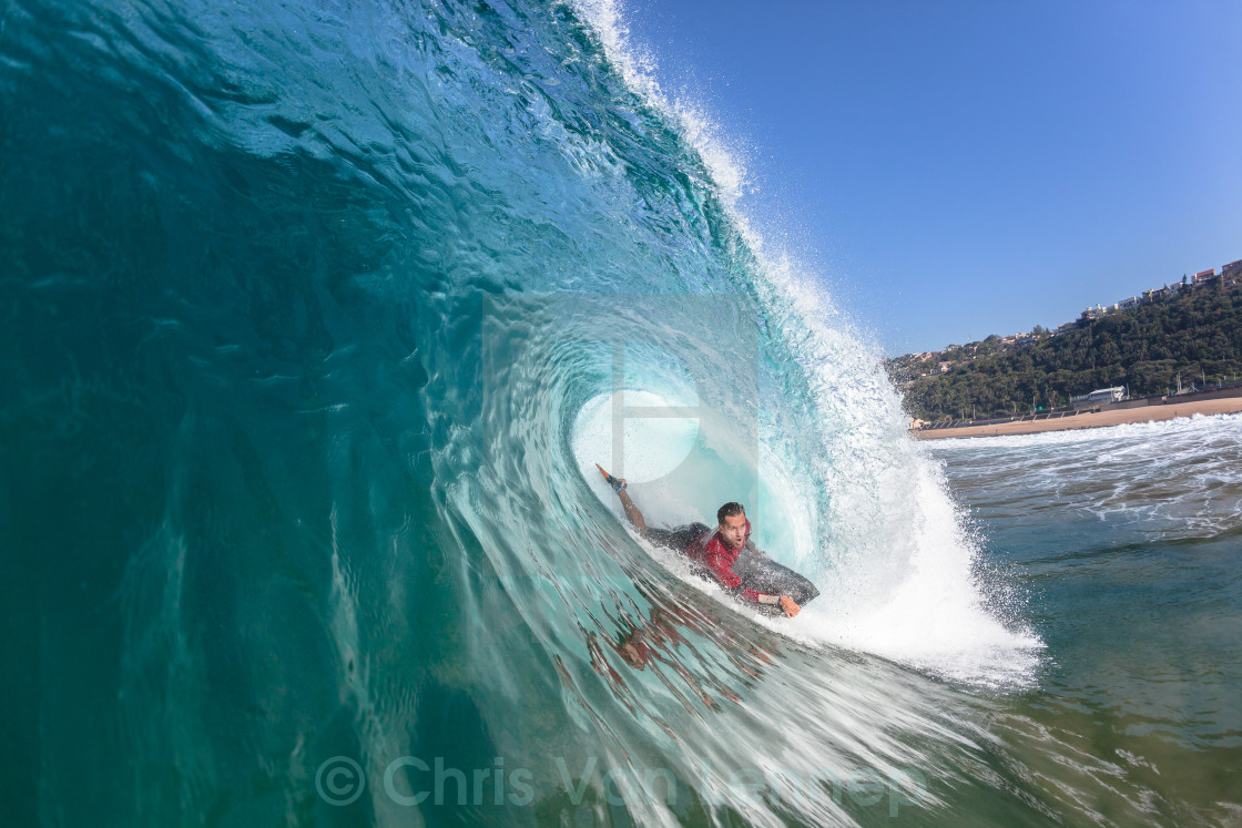 """Surfing Body-Boarder Hollow Blue Wave"" stock image"