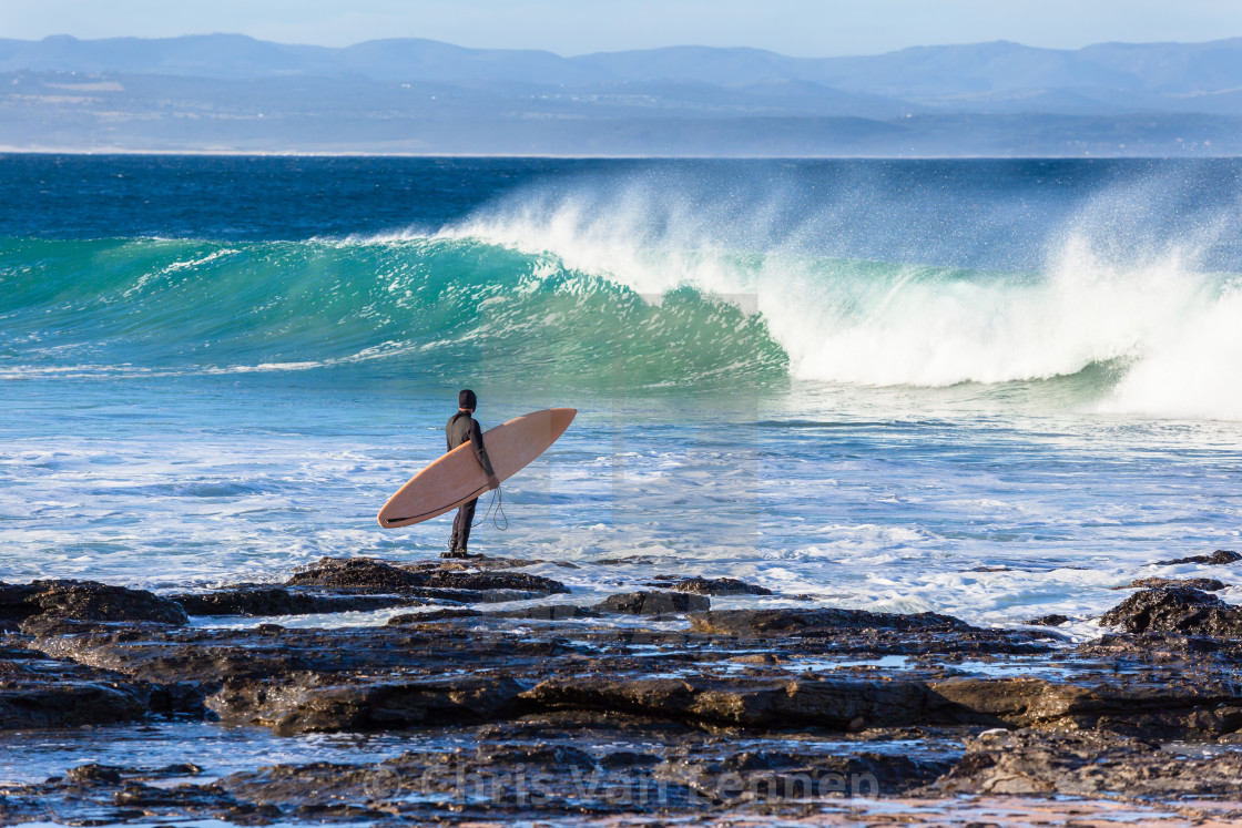 """""""Surfer Going Surfing Rock Entry Waves"""" stock image"""