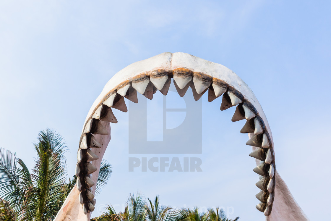 """Large Shark Teeth Model Statue Outdoors"" stock image"