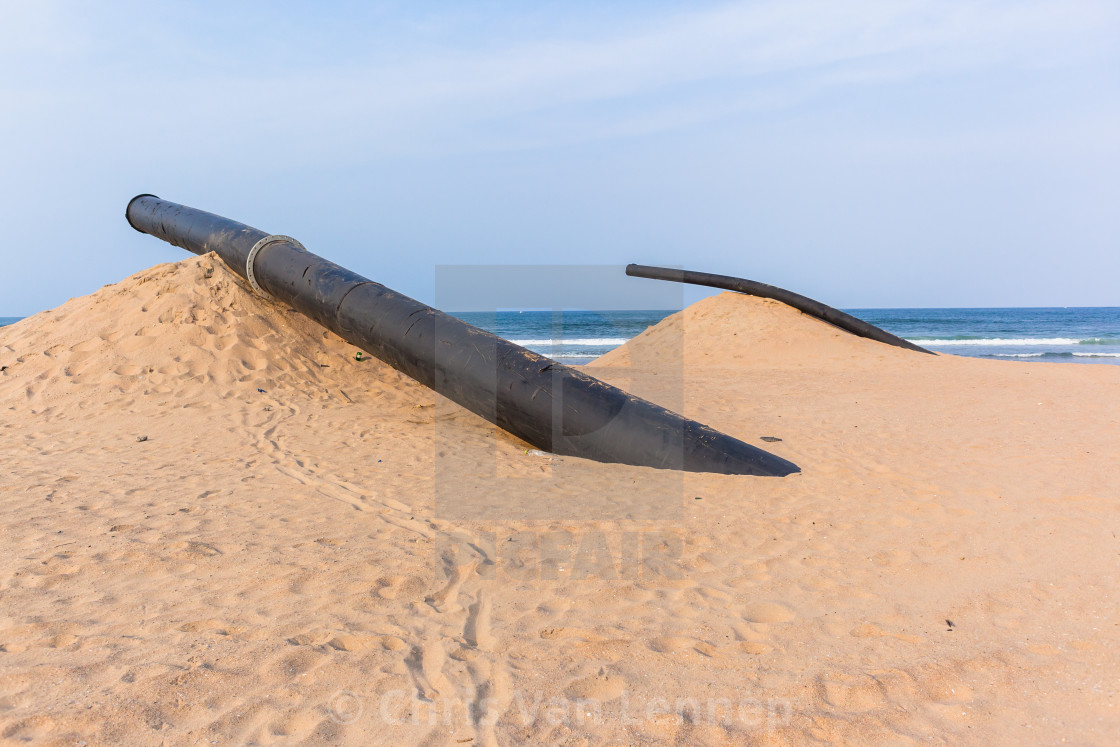 """Long Black Pipe Beach Ocean"" stock image"
