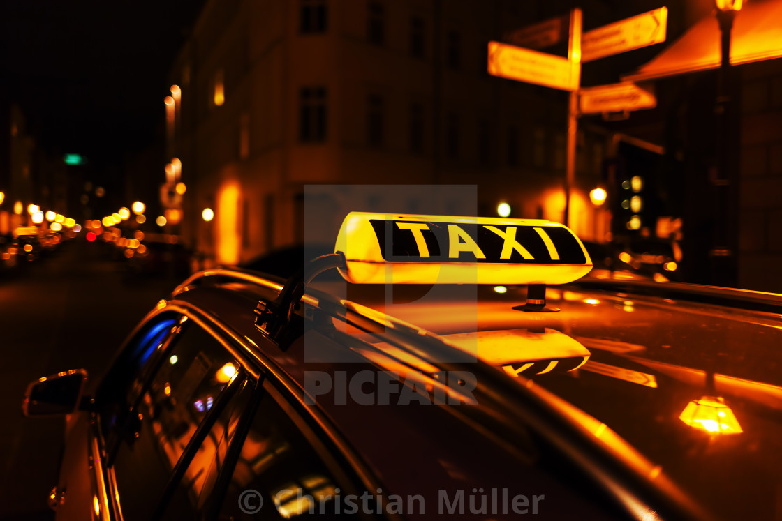 """taxi at night"" stock image"