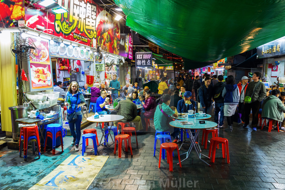 """street restaurant in Hong Kong at night"" stock image"