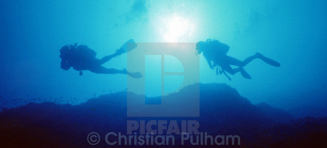 """""""Diver silhouettes"""" stock image"""
