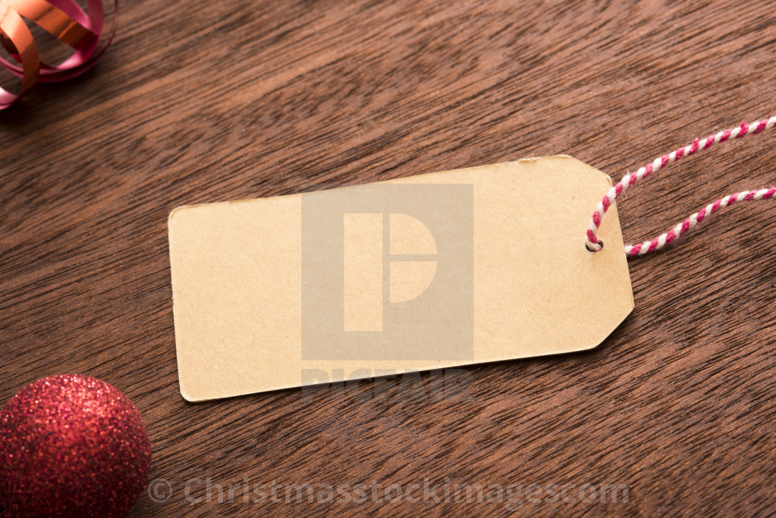 """Blank gift tag with Xmas decorations"" stock image"
