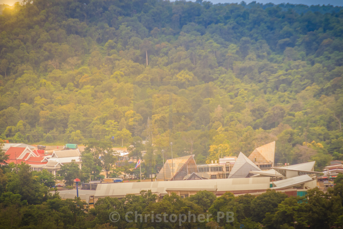 """Peaceful forest and mountains over Chong Mek checkpoint terminal, the land..."" stock image"