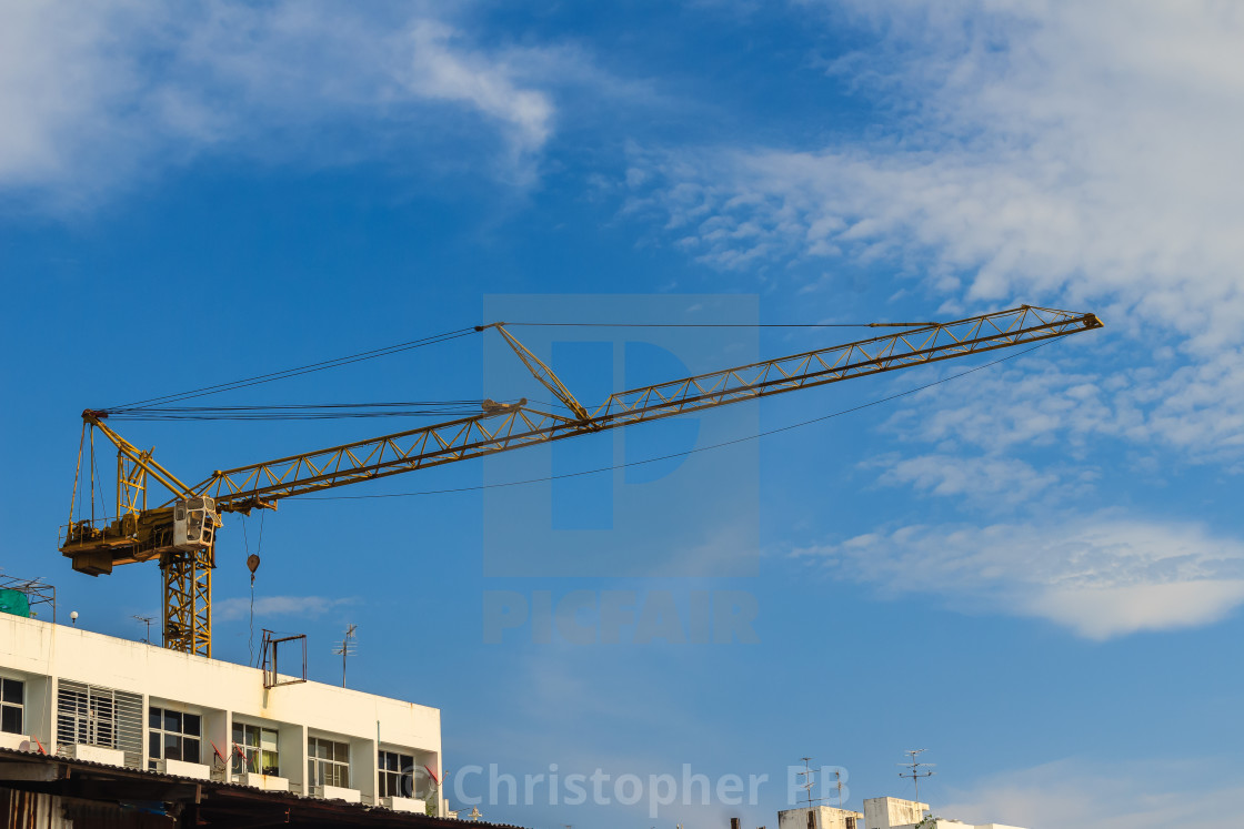Luffing jib tower crane at large scale construction site