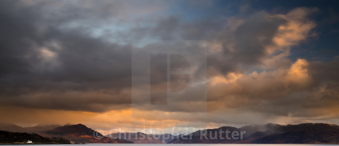 """Dramatic sunset over the mountains"" stock image"