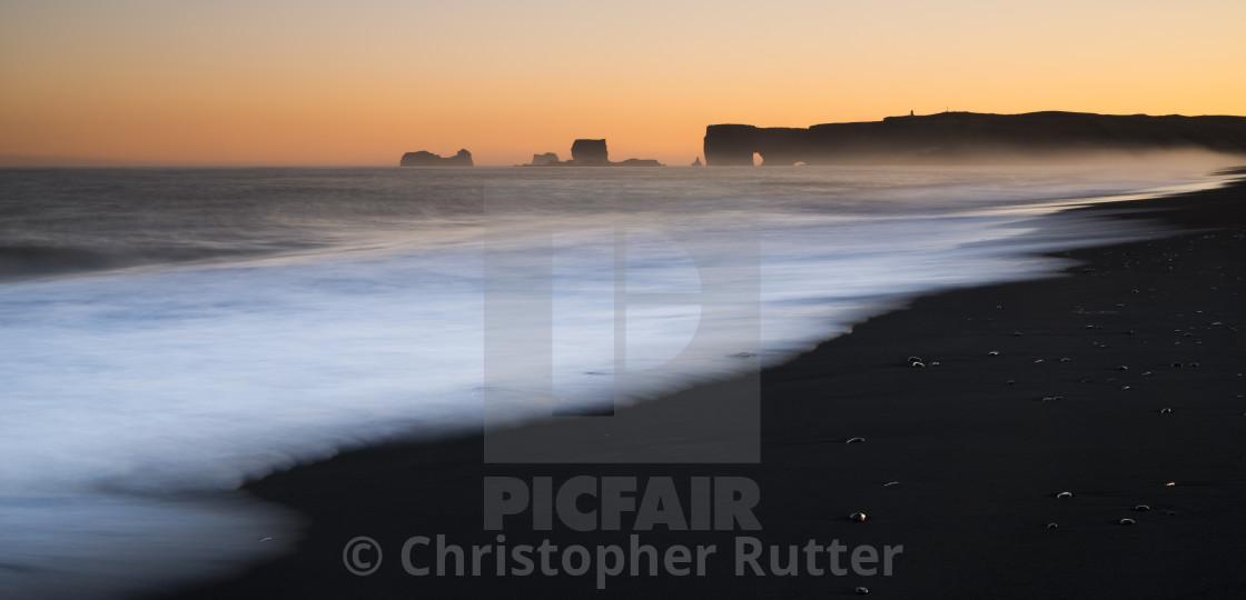 """Waves at sunset Reynisfjara beach, Iceland"" stock image"