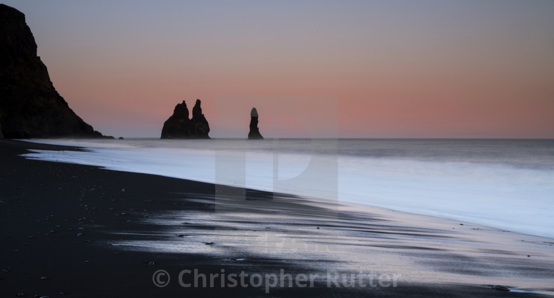 """Reynisdrangar sea stacks, pink sunset"" stock image"