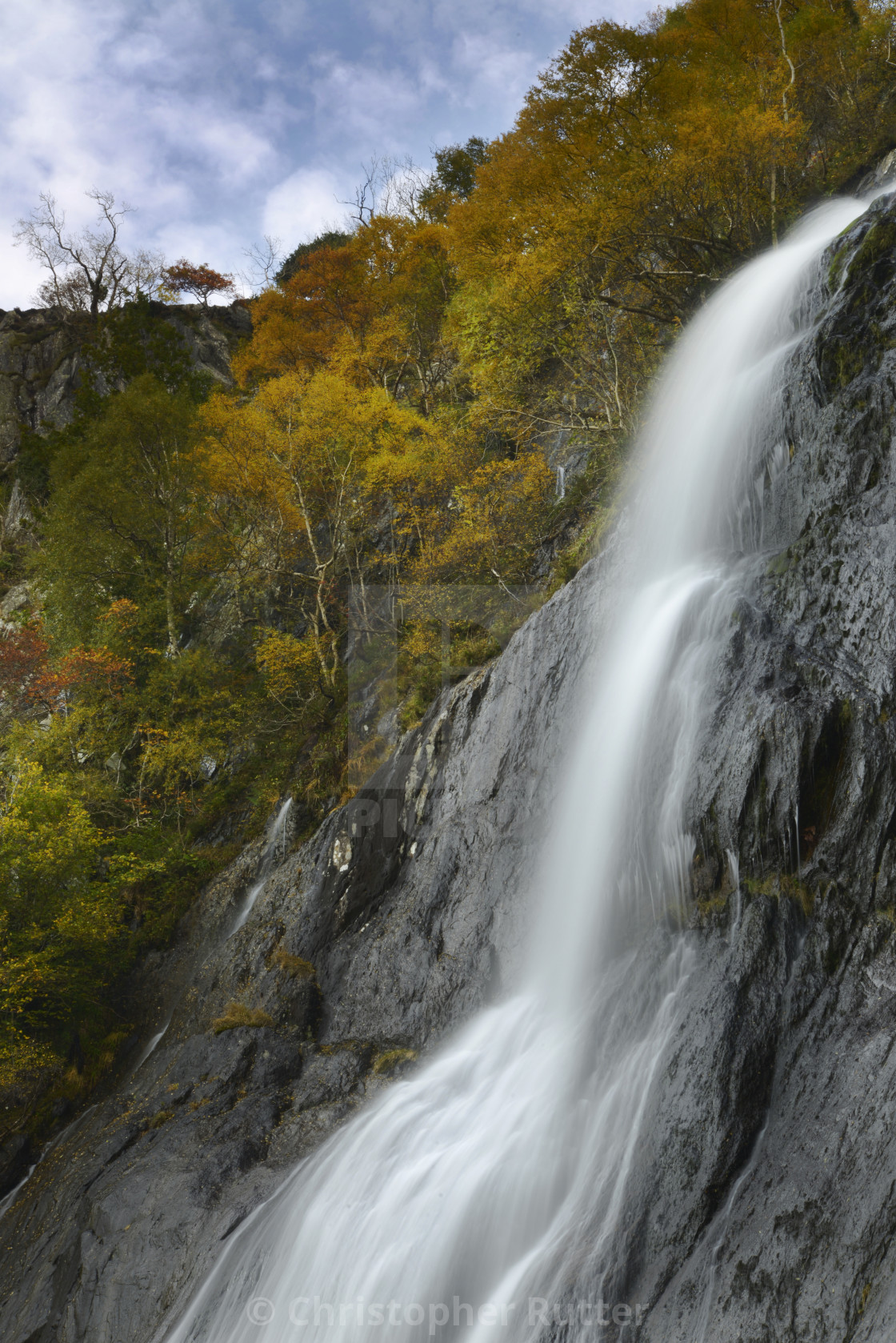 """Aber Falls, North Wales, with autumn trees"" stock image"