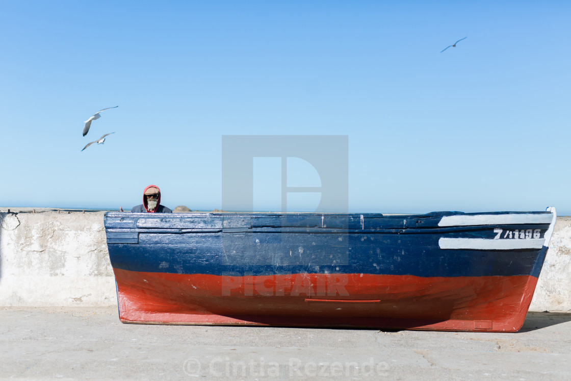 """Man in a boat"" stock image"