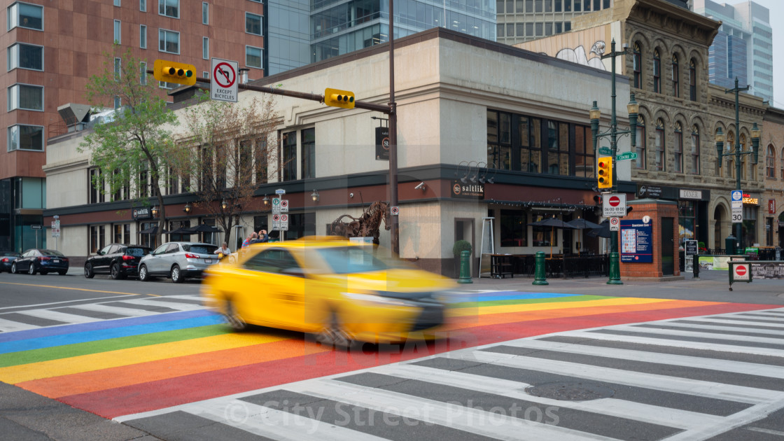 """Yellow Cab driving over a crossing"" stock image"