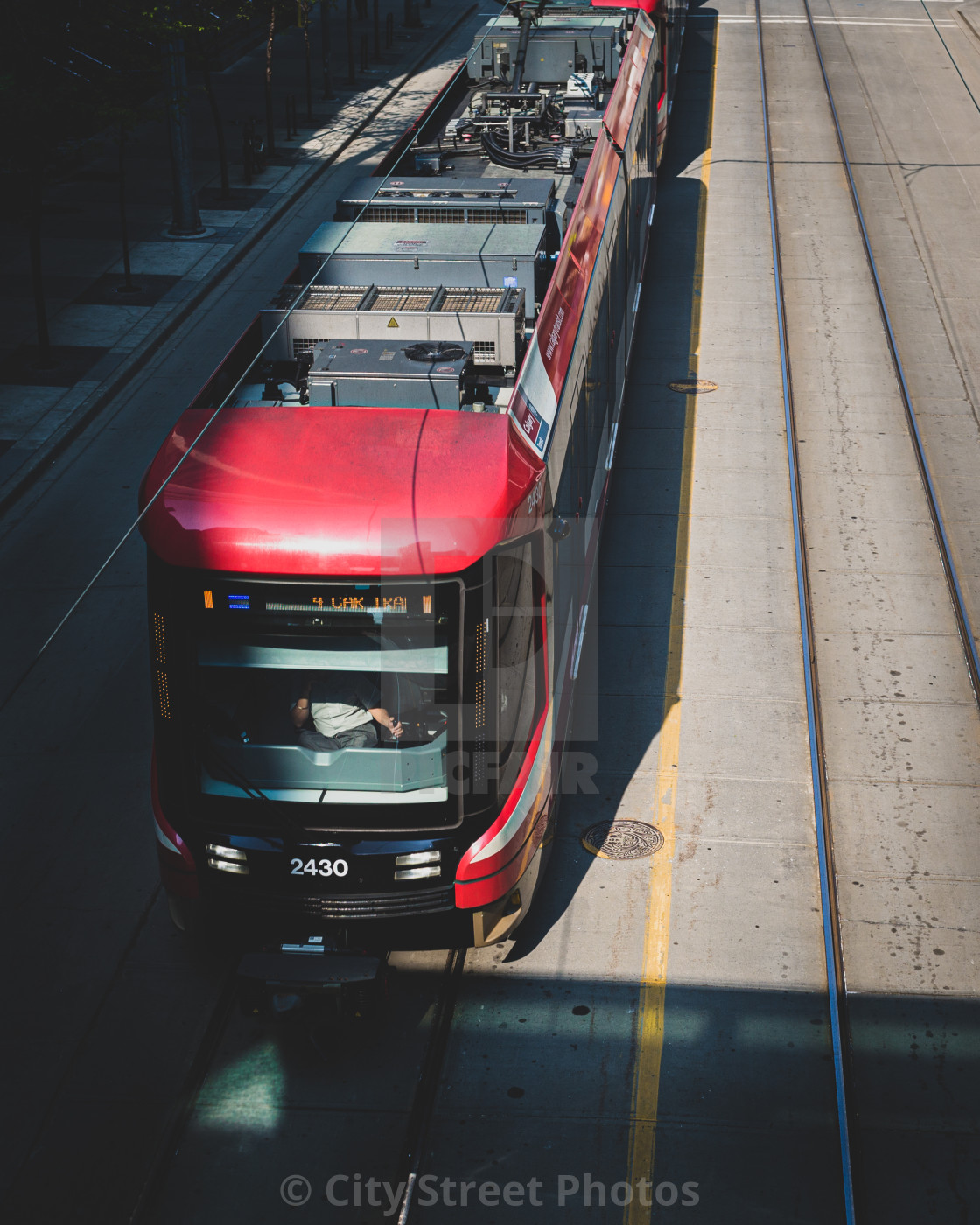 """Commuter train passing under a walkway"" stock image"